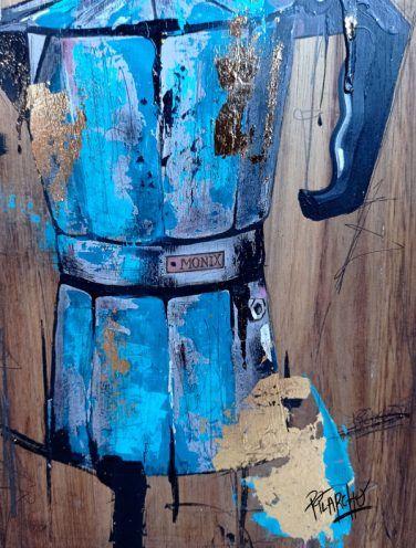 Detalle de cafetera Monix azul sobre madera tratada y envejecida